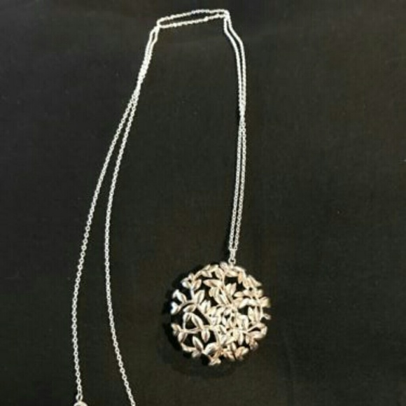 de4f02cb4 Paloma Picasso Olive Leaf Medallion Pendant. M_5c528d433c984431f76b83fe.  Other Jewelry you may like. Tiffany & Co.